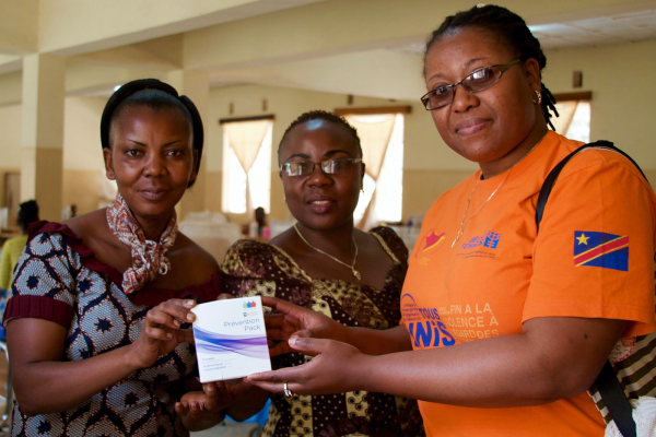 Three members of the Panzi Foundation team pose with award.